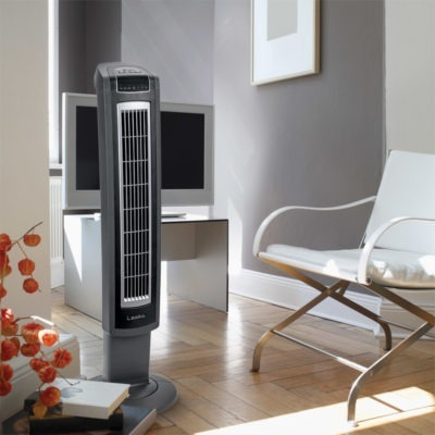 modern living room with white chair, wood floors and Lasko Tower Fan, model T42552
