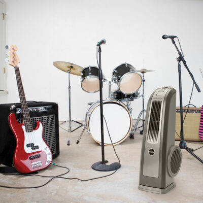 The Oscillating High Velocity Blower Fan, Model 4924 by rock and roll instruments in a room.