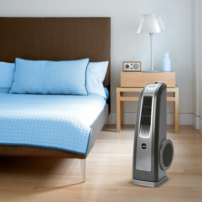 The Oscillating High Velocity Blower Fan, Model 4924 in a bedroom.