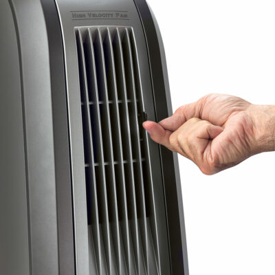 A close view of the front of the Oscillating High Velocity Blower Fan, Model 4924. A hand is adjusting the fan.