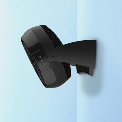 A side view of the Power Circulator Fan with Remote Control, Model A10802 hanging on a blue wall.