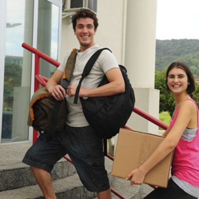 Two students moving into college