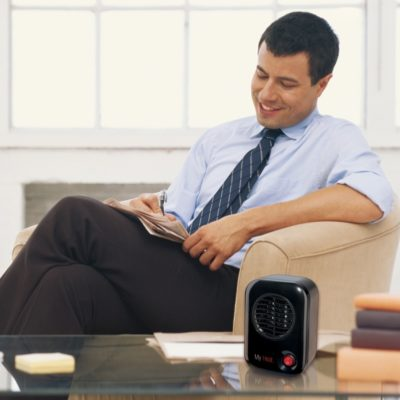 Lasko MyHeat™ Personal Heater - Black Model 100 on coffee table