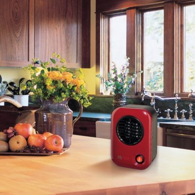 Lasko MyHeat™ Personal Heater – Blue, Model 103 On kitchen counter