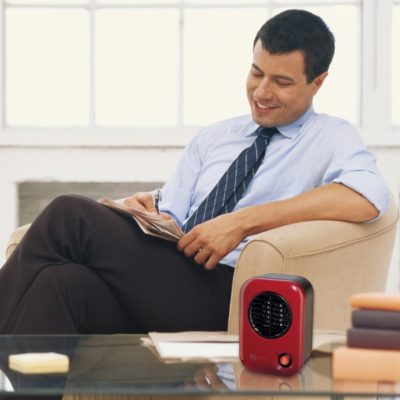 Lasko MyHeat™ Personal Heater – Blue Model 103 on coffee table