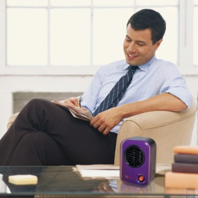 Lasko, MyHeat™ Personal Heater – Blue, Model 106, sitting on coffee table