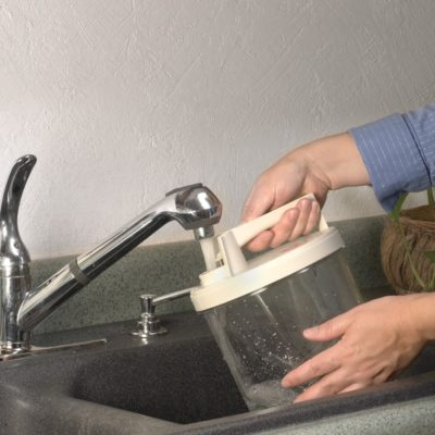 Person filling a container with water