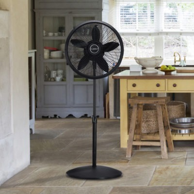 Lasko Black Pedestal Fan Model 1827 in rustic kitchen