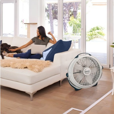 woman on couch with Lasko Fan Model 3300