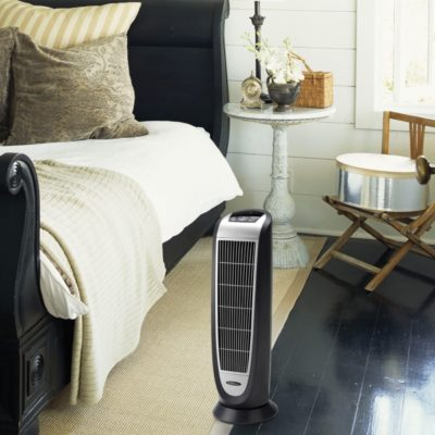 Lasko Digital Ceramic Tower Heater with Remote Control Model 5160 in bedroom