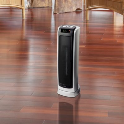Lasko Remote Control Ceramic Tower Heater with Digital Display Model 5521 in living room