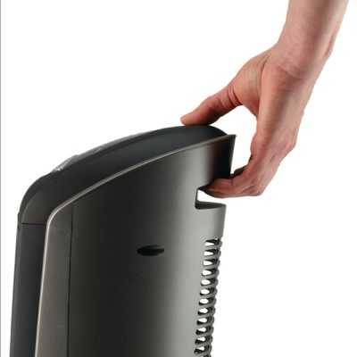 Person's hand holding the carry handle on Lasko Heater Model 751320