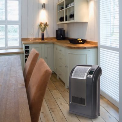 Lasko Cyclonic Digital Ceramic Heater, Model CC24842, in kitchen