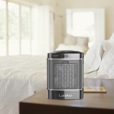 Lasko Simple Touch Ceramic Heater, Model CD08500, on bedside table