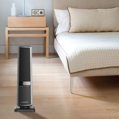 Lasko, Ceramic Tower Heater with Remote Control, Model CT22650, in modern bedroom