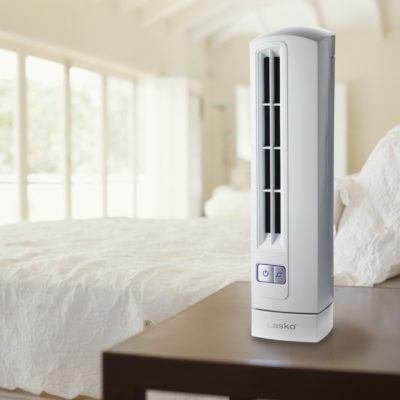 lasko Air Stik® Ultra Slim Oscillating Fan - White model T14100 in bedroom