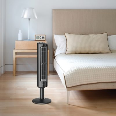 lasko Oscillating Tower Fan with Twin Grills model T38301 in bedroom