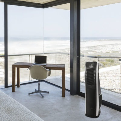 lasko Oscillating 4-speed High Velocity Fan model c32145 near Desk in modern bedroom overlooking ocean