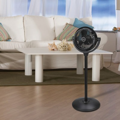 lasko 34″ Compact Power Pedestal Fan with Remote Control model S08600 in living room