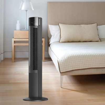 Lasko 5-Speed Wind Curve® Tower Fan with Ionizer model T42915 in bedroom