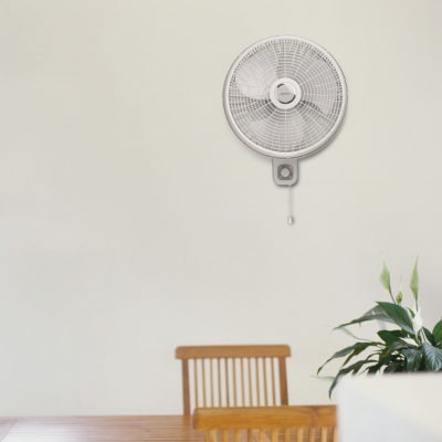Lasko Oscillating Wallmount Fan with 3 speeds Model M16900 in living area near chairs and plant