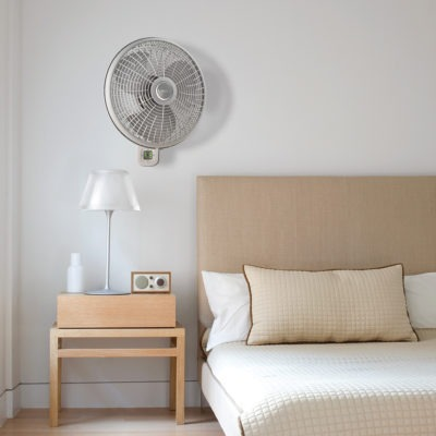 Lasko Oscillating Wall Mount Fan with 3 Speeds and Remote Control Model M16950 in bedroom