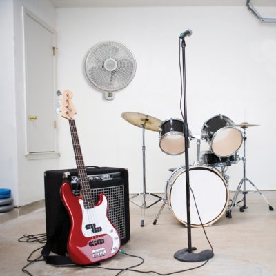 Garage with musical instruments and tools and Lasko Wallmount Fan