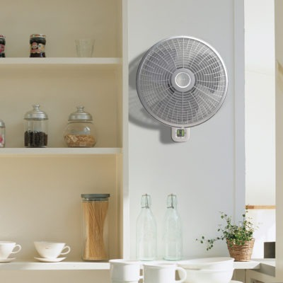 Lasko Oscillating Wall Mount Fan with 3 Speeds and Remote Control Model M16950 in kitchen
