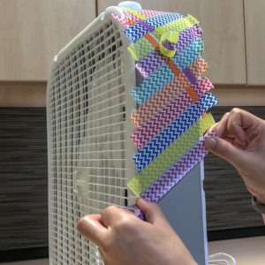 Lasko box fan makeover with washi tape - step 1
