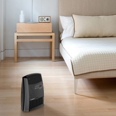 Lasko Digital Ceramic Heater with Warm Air Motion Technology Model CC13700 in a bedroom
