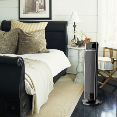 Lasko Digital Ceramic Tower Heater with Remote Control Model CT30754 in bedroom