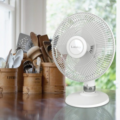 tilt back fan head diagram Lasko White Performance Table Fan, model D12225, on kitchen counter