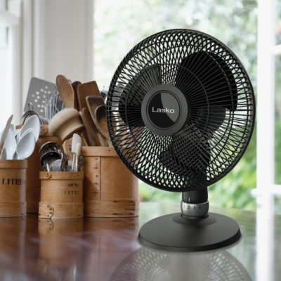 Lasko Black Table Fan, model D12525 on Kitchen Counter