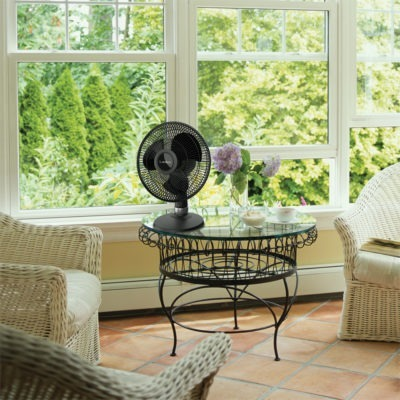 Lasko Black Table Fan model D12525 on sun room table