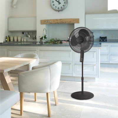 Modern kitchen with Lasko black pedestal fan, model S16612