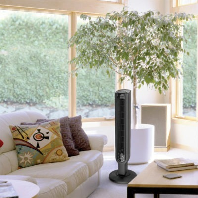 Lasko Oscillating Tower Fan with Remote model T36211 in living room