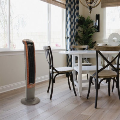 Lasko Wind Curve Oscillating Tower Fan with Remote, model T42964 in dining room