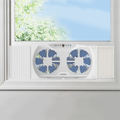 Electrically Reversible Twin Window Fan with Bluetooth, model W09560 in window