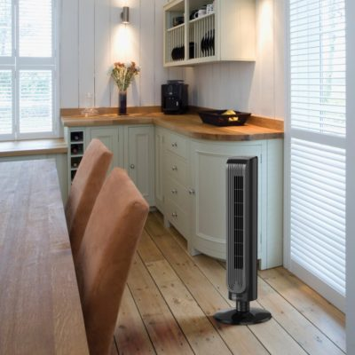 Lasko Oscillating Tower Fan with Remote Control Model T32202 in dining room