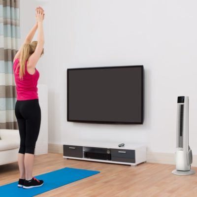 Lasko Hybrid Tower Fan with Remote Control Model T38400 in exercise room