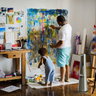 Father and Son Painting in Studio with Lasko Bladeless Fan Nearby