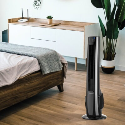 Lasko Hybrid Tower Fan with Remote Control Model T38415 in bedroom