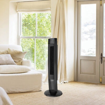 white plush living room with Lasko Wind Tower® Fan with Nighttime Mode and Remote Control, model T36510